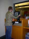 Self Check out station by Seattle University Law Library